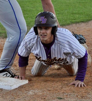 SBHS leadoff hitter Charles Keith dives back into first base safely during a recent game. In a 14-2 win over Lake Charles Prep on Thursday, Keith had a hit, a run scored and an RBI.