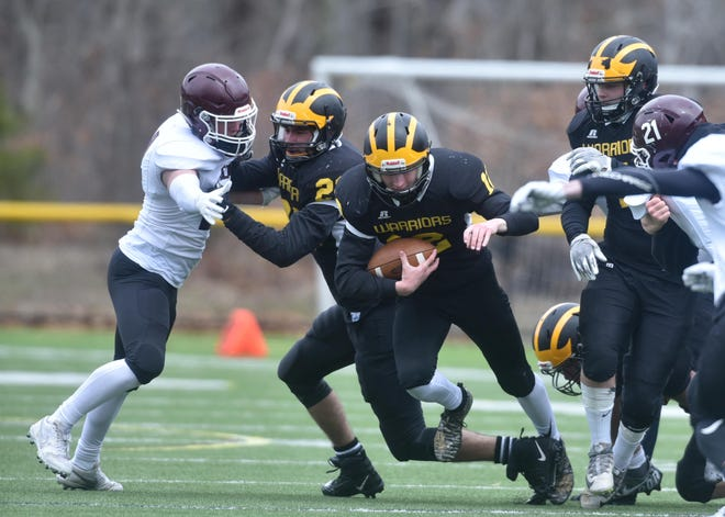 Nauset's Riley Holmes rushed for two touchdowns in a win over Falmouth last week in North Eastham. The Warriors conclude their season tonight at Dennis-Yarmouth.
