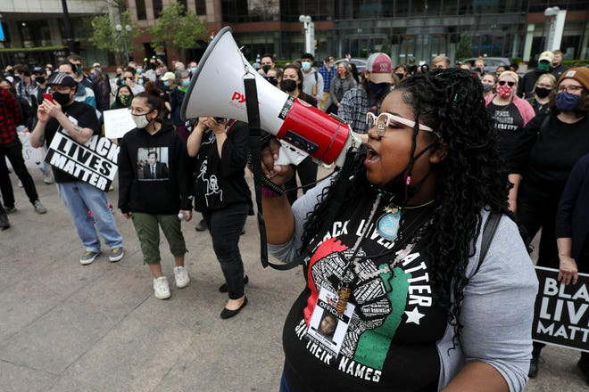 Rally organizer Kiara Yakita leads protesters in a chant before taking to South High Street to march in protest of continued incidents of police killing Black men and women across the country. The protesters marched on Downtown streets and then returned to the Ohio Statehouse where the rally started.