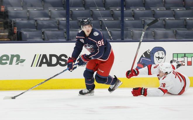 Blue Jackets center Jack Roslovic, here skating past Carolina  defenseman Brady Skjei on March 25, has been impressive on offense.