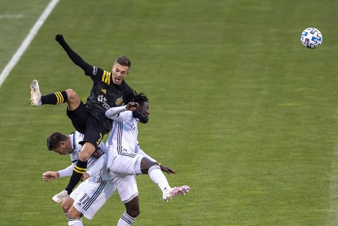 Crew forward Pedro Santos battles for a head ball in a 2-1 win over Philadelphia on Nov. 1.