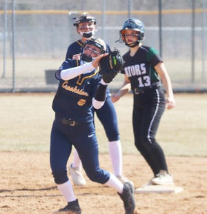Kenze Epema catches a popup against Badger/Greenbush-Middle River on April 17. Epema and the Pirates fell 14-1 at Thief River Falls on Thursday.