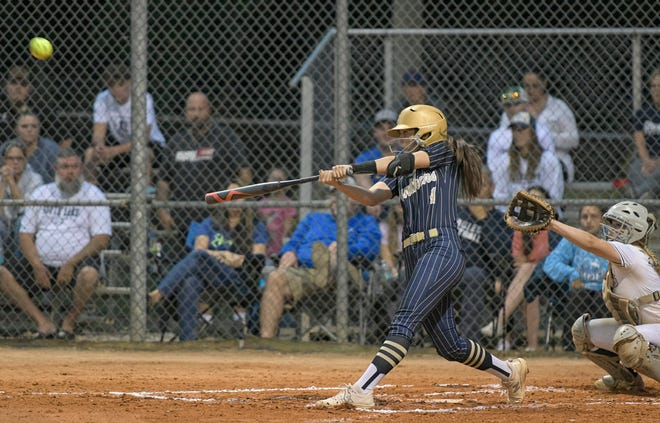Eustis' Ainsley Perdicaris (4) cracks a two-run homer during Friday's game against South Lake at the Panther Den in Eustis. [PAUL RYAN / CORRESPONDENT]
