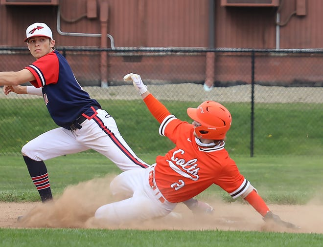 Meadowbrook's Zak Hoop (21) slides safely into third base during Saturday's 3-2 victory over Indian Valley in Byesville.