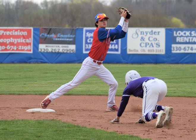 West Holmes shortstop Nick Ginsburg takes a throw from second baseman Addison Yates to force Triway's Colton Snyder at second on a fielder's choice. The Knights played solid defense behind Noah Clark to top Triway 2-1.
