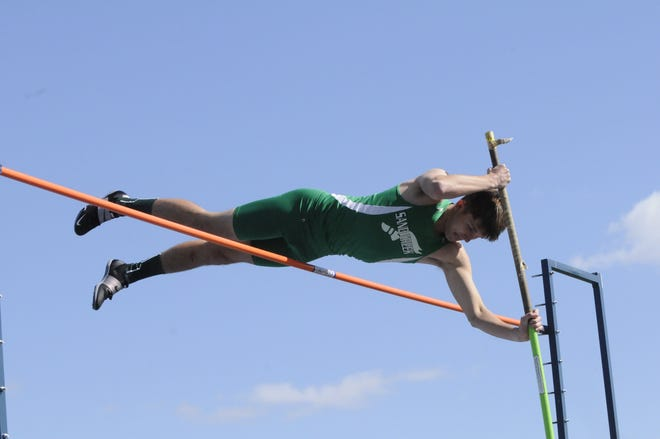 Sand Creek's Jacob Alston clears the bar during the pole vault event at Friday's Coach Bob Beckey Memorial Invite.