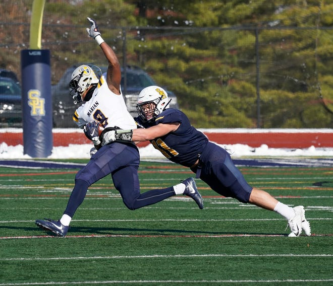 Siena Heights linebacker Kole Murlin makes a tackle during a game in the 2019 season against Marian.