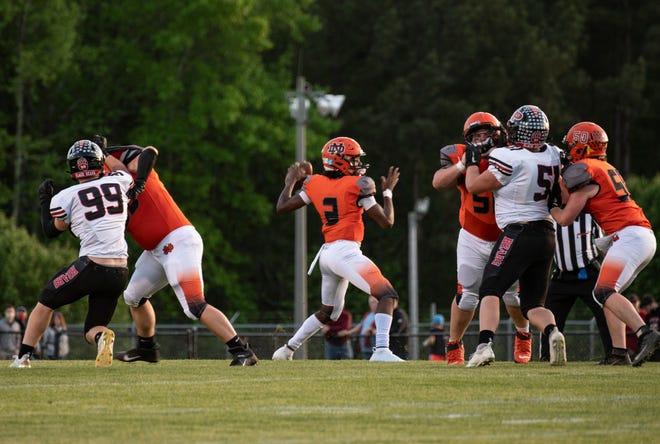 North Davidson High School quarterback Tedric Jenkins steps back to pass against Pisgah High School during a drive on April 16, 2021, in Lexington.