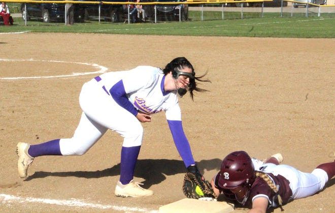 Bronson's Kaylee Withington tries to catch a Buchanan base runner napping at first base Friday afternoon.