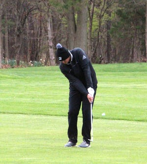 Coldwater's Jett Galloway chips on to the green on the 9th hole Saturday at the Cardinal Golf Invite. Galloway finished in a tie for 4th place on his home course.