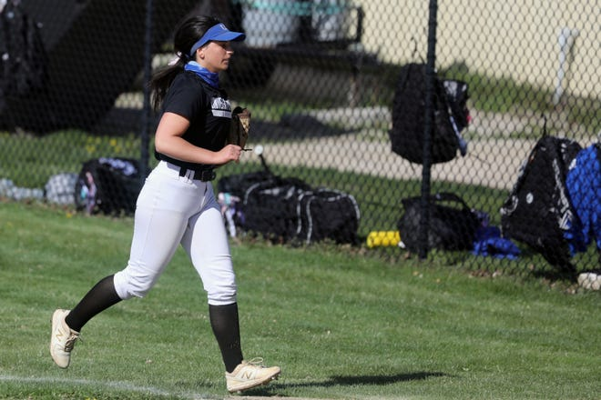 University of Dubuque's Emily Bloomer (7) heads back to the dugout during the first game of a doubleheader against Iowa Wesleyan University Tuesday April 13, 2021, at the Mapleleaf Athletic Complex in Mount Pleasant.