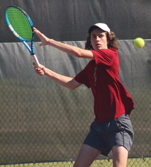 Episcopal's Walker Jarvis prepares a shot in an FHSAA district boys tennis match. The Eagles enter regionals as district champions.