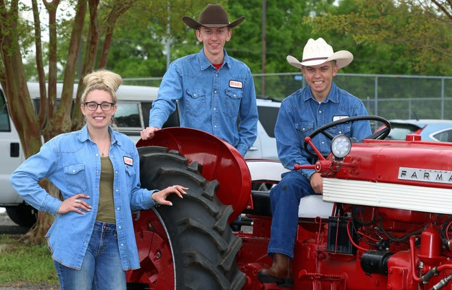 Caroline Young, Brody Davis and T.J. Bryant pose together during a Future Farmers of America event held Saturday, April 17, 2021, at Crest High School in Boiling Springs.