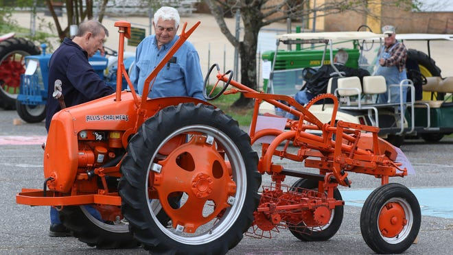 Herman Hamrick and Wayne Camp check out a 1948 Allis Chalmers Model G tractor during a Future Farmers of America event held Saturday, April 17, 2021, at Crest High School in Boiling Springs.