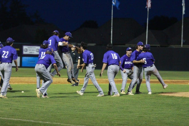 Dutchtown celebrates its 3-2 win over St. Amant. The victory gave them a two-game lead in the district standings.