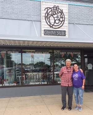 Jon Schallert, left, president of The Schallert Group, and Phyllis Brack, owner of Dilly & Doc Creative Studio, stand outside her storefront at 1119 Main Street in Great Bend, during a site visit in 2019. Schallert called on Brack to be a featured speaker at a recent International Main Street conference.
