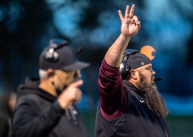 Peoria High head coach signals his players during their Big 12 semifinal game against Normal West on Friday, April 16, 2021 at Peoria Stadium.