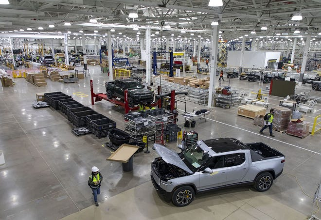 RT1 trucks are assembled and tested, April 14, 2021, before the new Rivian plant fully opens in Normal, Illinois. Rivian is preparing to manufacture electric truck and SUV models in the former Mitsubishi facility.