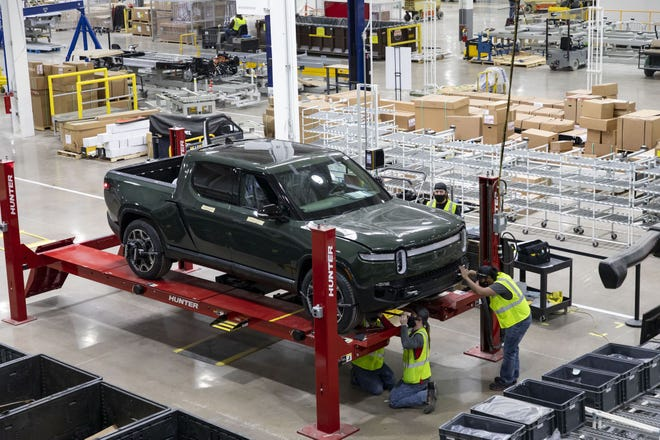 An R1T truck is assembled and tested on the factory floor at the Rivian plant in Normal.