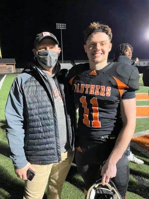 Jason Pollitt celebrates with his son Brock Pollitt  on Friday night after the Washington football team's win over Canton.