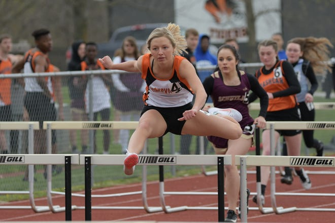 Kirksville's Kenslie Stufflebean clears a hurdle during the 100m hurdles event at the Tiger Invitational.