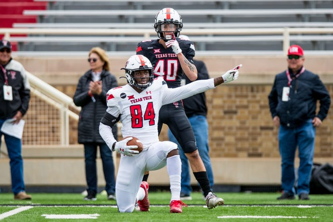 Texas Tech wide receiver J.J. Sparkman signals a first down after he caught a 38-yard pass from quarterback Donovan Smith during the Red Raiders' spring game Saturday at Jones AT&T Stadium. Sparkman caught a 34-yarder from Tyler Shough earlier in the game.