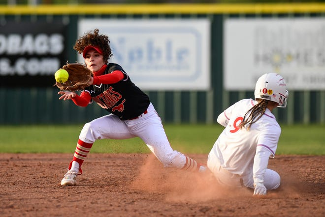 Monterey's Tatiana Trotter (9) slides safe ahead of the throw to Coronado's  Harley Garcia (11) during a softball game on Friday, April 16, 2021, in Lubbock, Texas. [Justin Rex/For A-J Media]