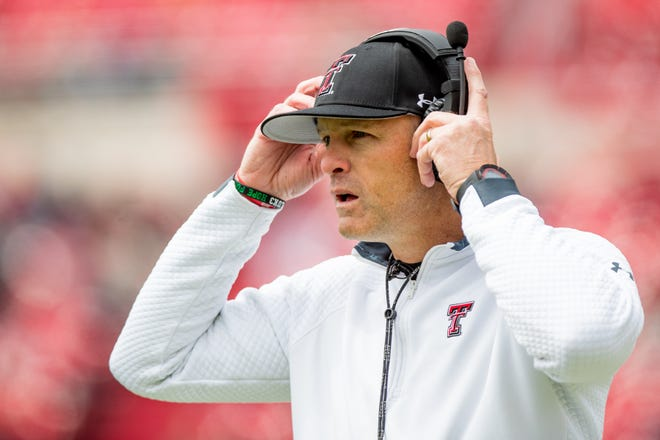 Texas Tech head coach Matt Wells puts on his headset during their annual spring game on Saturday, April 17, 2021, at Jones AT&T Stadium in Lubbock, Texas.