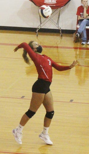 McClave High School's Gentry Martin serves the ball in Friday's match against Wiley. The Cardinals lost to the Panthers in three sets.