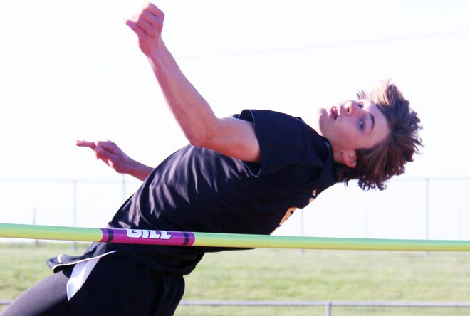 Versailles' Justin Hamrick looks to clear the bar in the high jump competition at the Maroon and Gold Relays in Eldon on April 15. Hamrick won the event with a height of 1.77 meters.