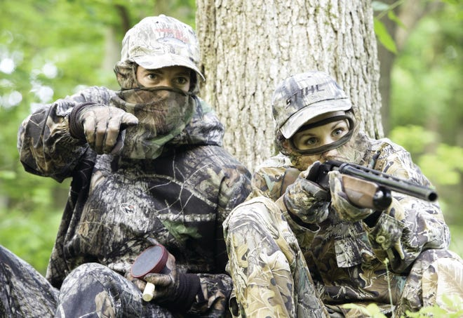Angela Belden and her guide, Wes, wait for turkey during a spring turkey hunting season near McBaine, MO.