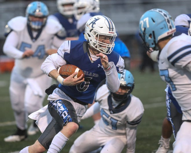Ashland senior Nick Fish picks up a first down during a football game against Medfield at Ashland High School on April 16, 2021. Fish scored three touchdowns in an overtime win over Medfield.