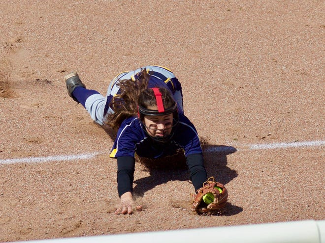 Whiteford shortstop Aly VanBrandt makes a diving catch of a popup against Bedford Friday.