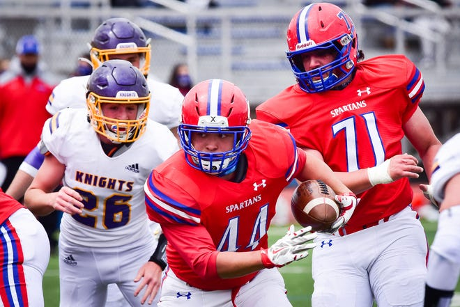 New Hartford player Paul Circelli (44) runs for some of his 53 yards against Holland Patent on Saturday at Don Edick Field. Circelli had a pair of touchdowns and was a key member of the defense for New Hartford, which won 38-0.