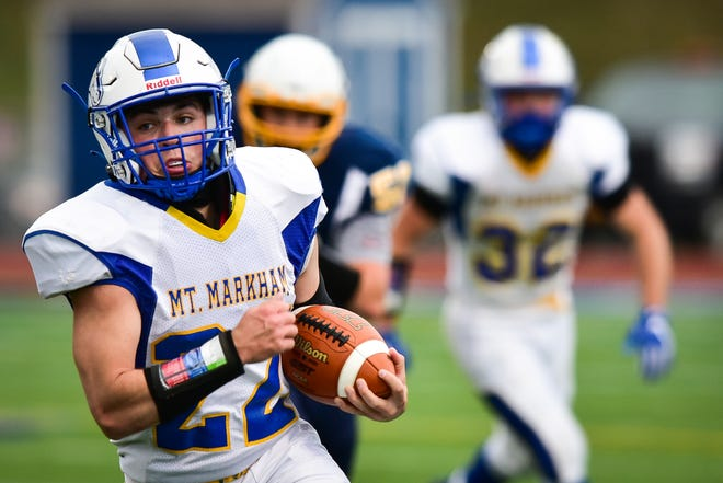 Mount Markham player Seth Capes (22) rushes the ball during the game against Central Valley Academy on Friday, April 16, 2021. Mount Markham won 34-0.