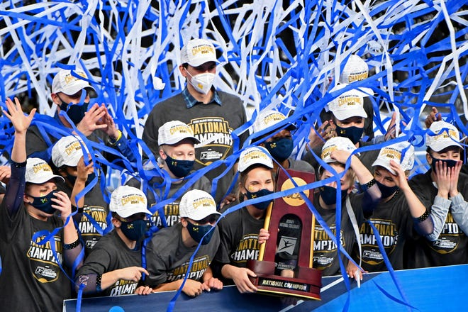 Michigan gymnasts celebrate with the national championship trophy Saturday afternoon in Fort Worth, Texas.