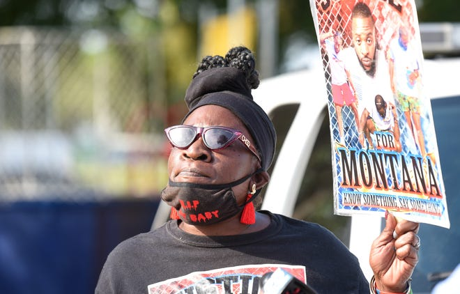 Riviera Beach resident Glenda Neal, whose son, Tommy Neal Jr., remains an unsolved murder case, speaks during a community outreach event hosted by the Riviera Beach Police Department at the Wells Recreation Center in Riviera Beach on Friday.