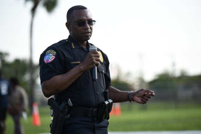 Riviera Beach Police Chief Nathan Osgood speaks to a gathered audience during a community outreach event hosted by the Riviera Beach Police Department at the Wells Recreation Center on April 16.