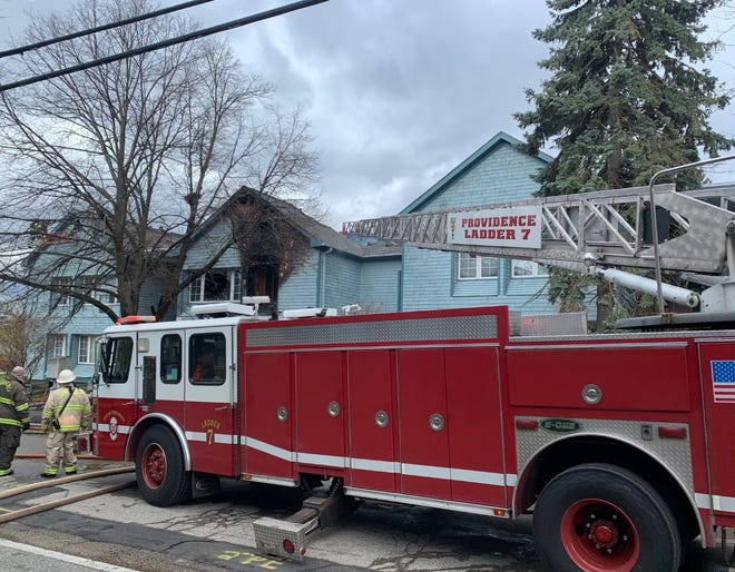 Providence firefighters respond to the apartment fire in the North End neighborhood of Charles on Saturday.