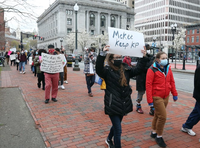 With the federal courthouse as their backdrop, protesters on Saturday stream past the Kennedy Plaza bus stops en route to locations outside the heart of downtown where the stops would be relocated.