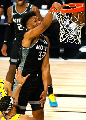 Aug 13, 2020; Lake Buena Vista, Florida, USA; Jabari Parker #33 of the Sacramento Kings dunks against the Los Angeles Lakers during the second quarter at The Field House at ESPN Wide World Of Sports Complex on August 13, 2020 in Lake Buena Vista, Florida. Mandatory Credit: Kevin C. Cox/Pool Photo-USA TODAY Sports