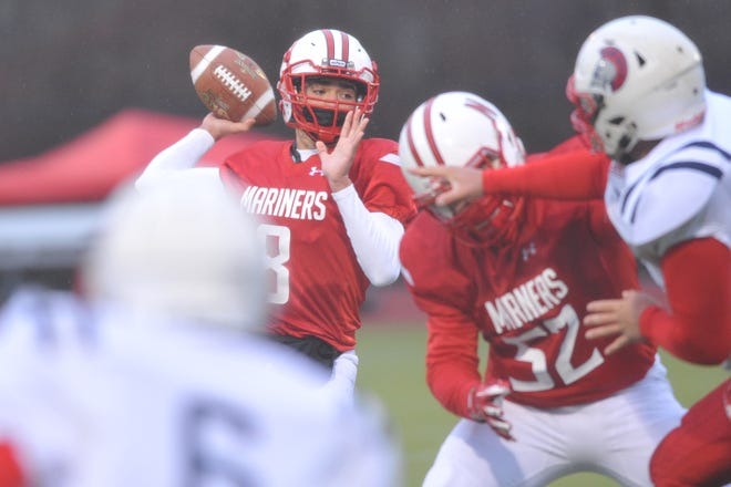 Narragansett's Phil Theroux gets ready to fire to a receiver during the first quarter against Toll Gate on Friday. Theroux threw two touchdowns in the quarter, both to Tyler Poirier, as the Mariners rolled to a 28-6 win.
