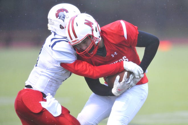 Narragansett's Reider Fry (shown in the Mariners' game against Toll Gate earlier this season) scored a pair of touchdowns Friday night against the Titans, helping Gansett earn a spot in the Division IV Super Bowl.