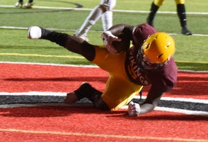 Edison's Jaylen Blacksher completes a touchdown during a varsity football game at Lincoln on April 16 in Stockton.