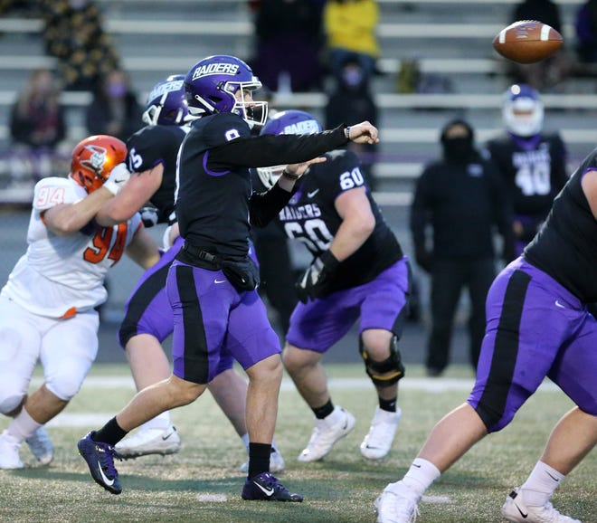 Braxton Plunk of Mount Union targets a receiver during their game against Heidelberg on Friday.
