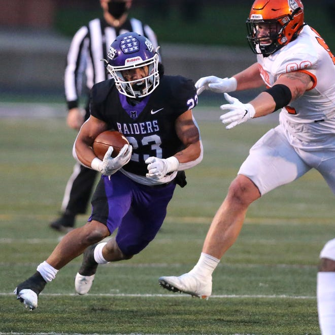 DeAndre Parker of Mount Union picks up yardage during their game against Heidelberg at Mount Union on Friday, April 16, 2021. The drive resulted in a touchdown.