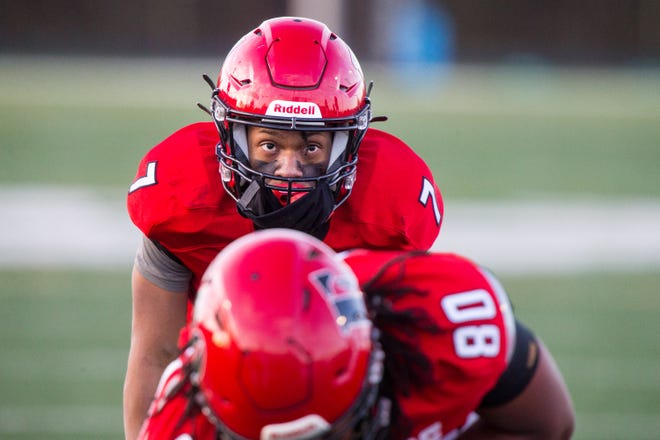 East's Shamar Lewis waits for the snap against Freeport in the first quarter of their NIC-10 game at Guilford High School Friday, April 16, 2021, in Rockford. Lewis overcame a severe knee injury to play this season and was awarded the Register Star's Passion & Perseverance Award.