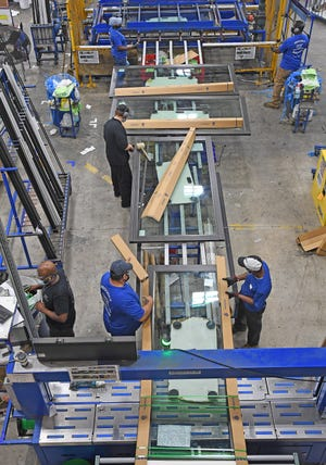 The assembly line area for PGT WinGuard Aluminum Sliding Glass Doors.