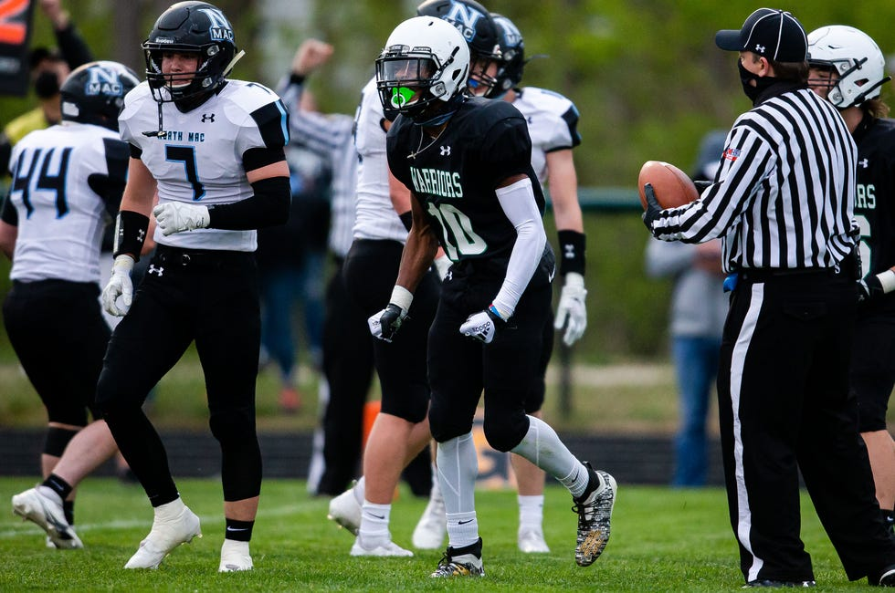 Athens' Ja'Kyan Shanklin (10) celebrates a touchdown against North Mac in the first half at Athens High School in Springfield, Ill., Friday, April 16, 2021. [Justin L. Fowler/The State Journal-Register]