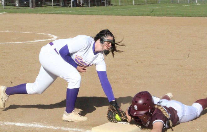 Bronson first baseman Kaylee Withington puts the tag on a Buchanan base runner diving back into the bag on Friday